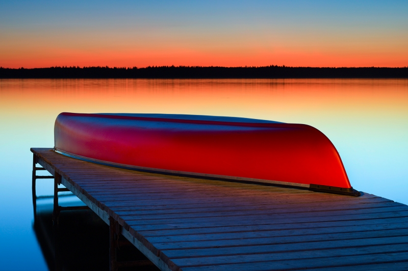 Mosquito on Red Canoe by Craig Stocks